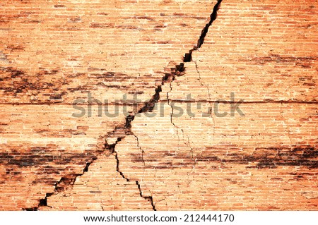 Broken brick wall with crack   - stock photo