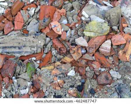 Broken bricks and stones rubble background closeup