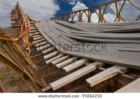 Broken Bridge. Temporary bridge is broken because the weight of the truck. - stock photo