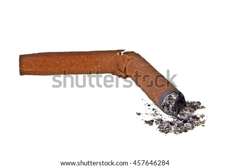 Broken brown cigar with ash on a white background - stock photo