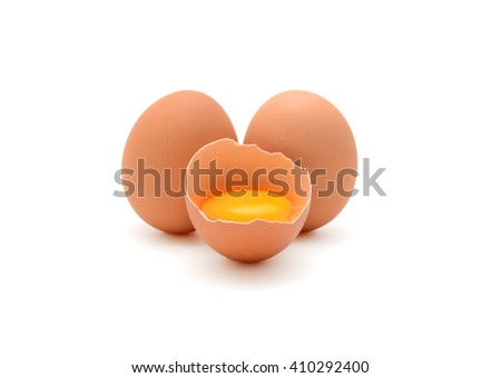 Broken brown eggs isolated on white background