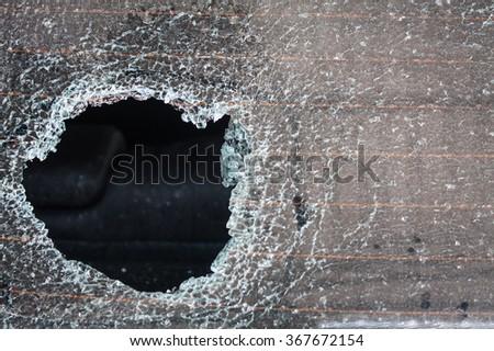 Broken car glass texture close up - stock photo