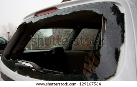 Broken car window - stock photo