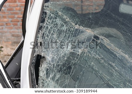 Broken car windshield. Car accident. Selective focus - stock photo