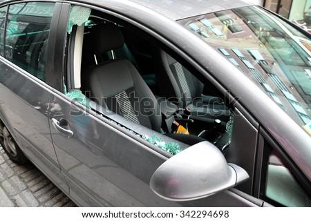 broken car windshield, car theft - stock photo