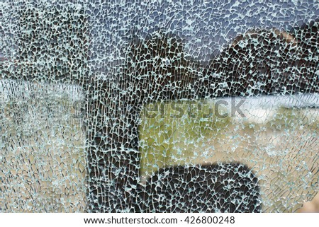 broken car windshield. road accident of car and smashed windscreen  - stock photo