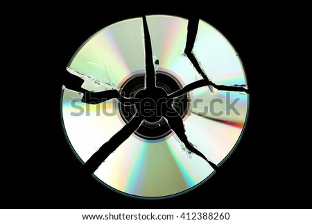 broken cd isolated on black background
