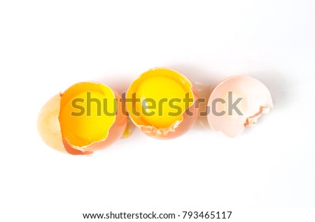 Broken chicken eggs isolated on white background.