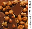 Broken chocolate bar and nuts - stock