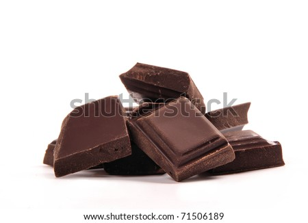 Broken chocolate bar on a white background - stock photo