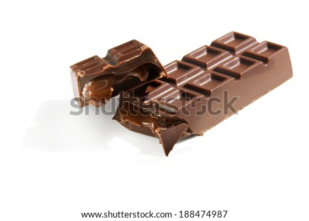 broken chocolate candybar with caramel stuffing on a white background isolated