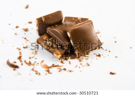 broken chocolate isolated over white