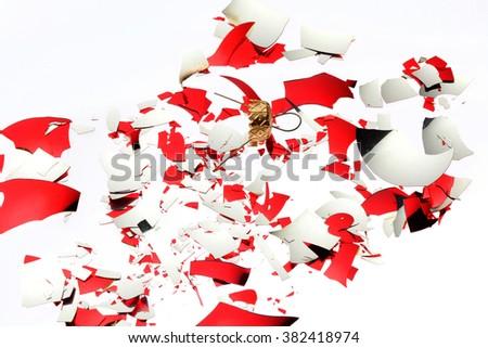 Broken christmas ball on white - stock photo