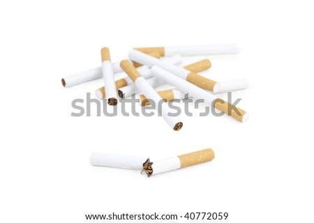 Broken cigarette and several cigarettes on background