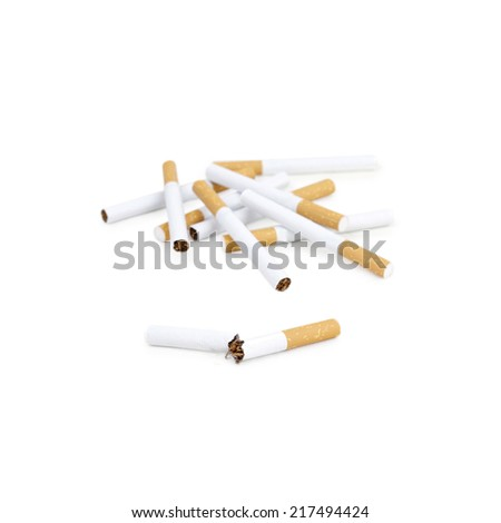 Broken cigarette and several cigarettes on background. Closeup