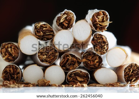 Broken cigarette ends in a heap concept for quitting smoking and healthy lifestyle - stock photo