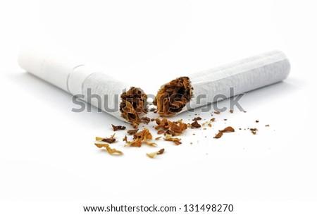 Broken cigarette on white - stock photo