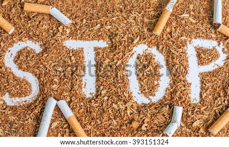 Broken cigarettes and tobacco. Stop smoking now