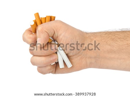Broken cigarettes in hand isolated on white background - stock photo