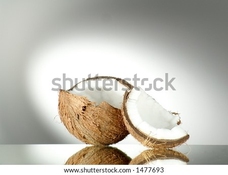 Broken Coconut on radial degrade background - stock photo