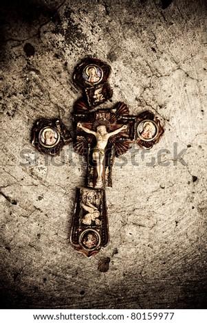Broken cross on stone texture - stock photo