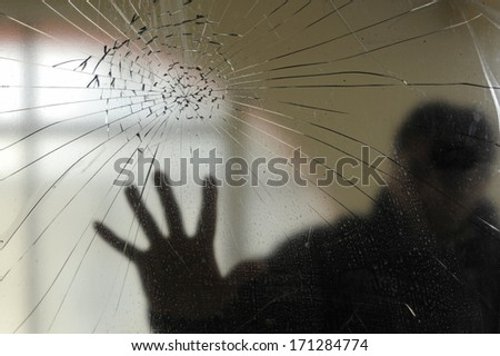 broken crystal with silhouette 1 - stock photo