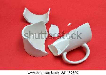 broken cup on bright background - stock photo