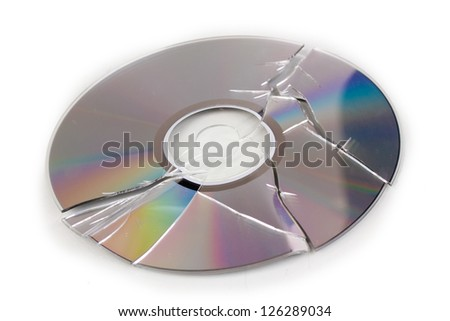Broken disk with information isolated on white - stock photo