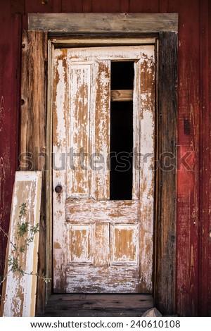 broken door on abandoned home - stock photo
