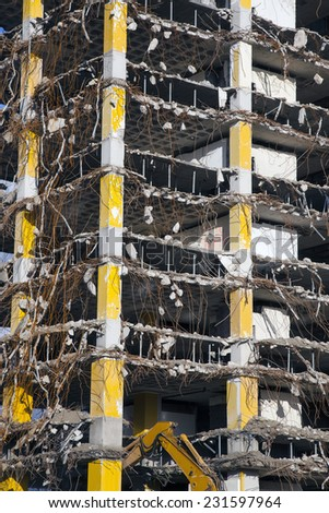 broken down large building during demolition - stock photo