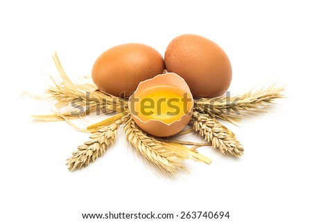 Broken egg with corn on white background - stock photo