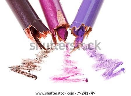 Broken eye shadow pencil with stroke sample, isolated on white macro - stock photo