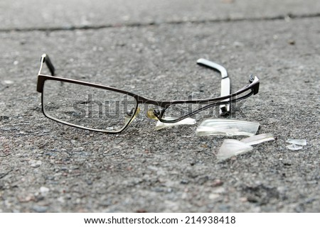 broken eyeglasses on concrete - stock photo