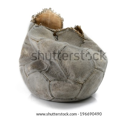Broken football isolated - stock photo