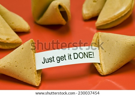 Broken Fortune Cookie Saying, 'Just Get It Done!'  - stock photo