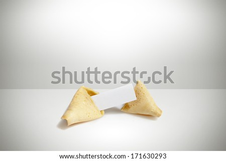 broken fortune cookie with paper tag