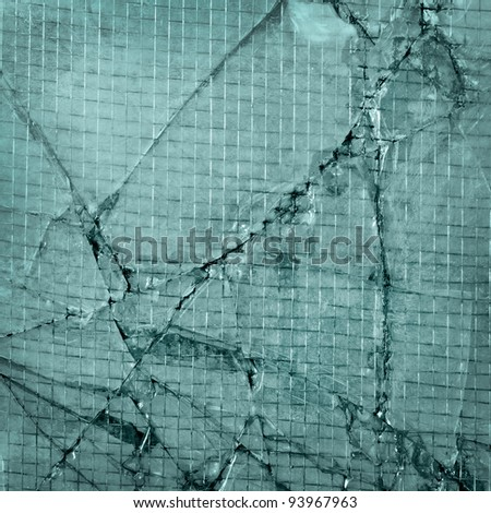 broken glass background of cracked window with wires blue - stock photo