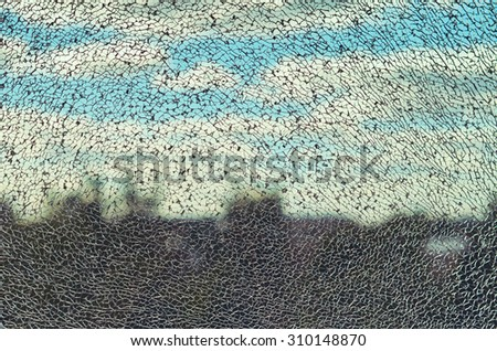 broken glass by the city and blue sky - stock photo