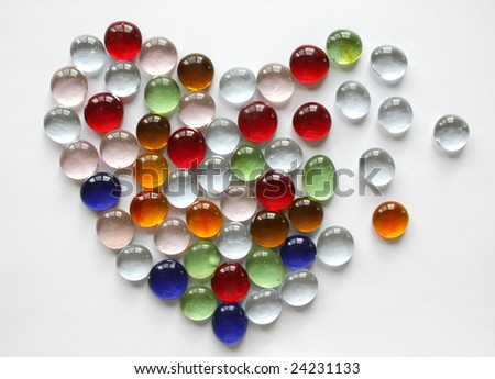 Broken Glass Heart against the Light Background