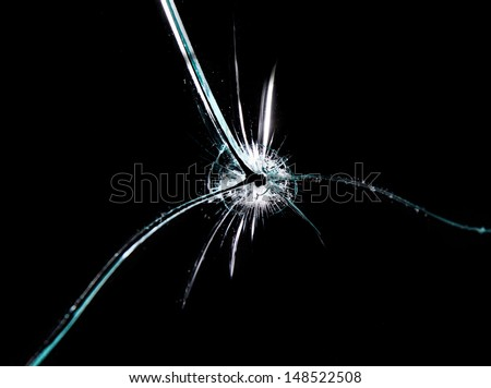Broken glass, isolated on black background - stock photo