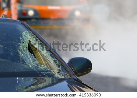 Broken glass of car in an accident and road roller   - stock photo