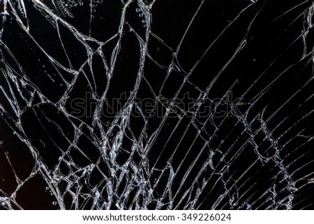 Broken glass on black background, concept of violence - stock photo