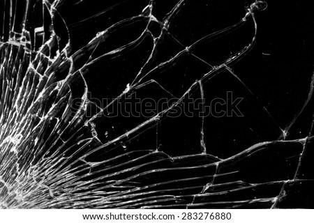 Broken glass - white lines on black background, design element - stock photo