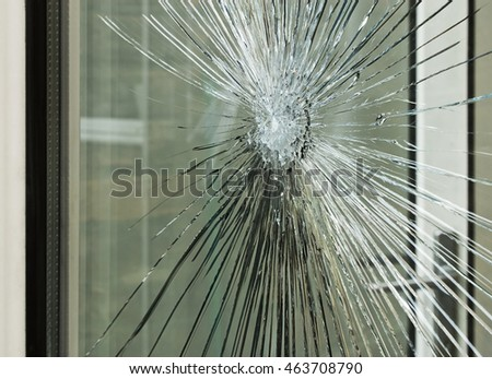 Broken glass window smashed by accident or after a break in, great for an insurance claim.