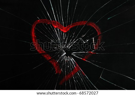broken glass with drawn heart - stock photo