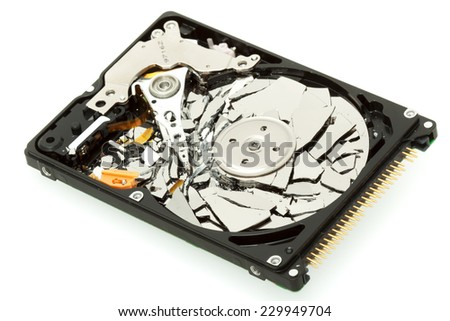 Broken hard drive disk, macro focused on magnetic head - stock photo