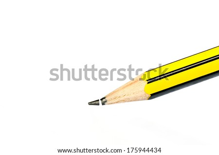 Broken head of sharp pencil on a white paper - stock photo