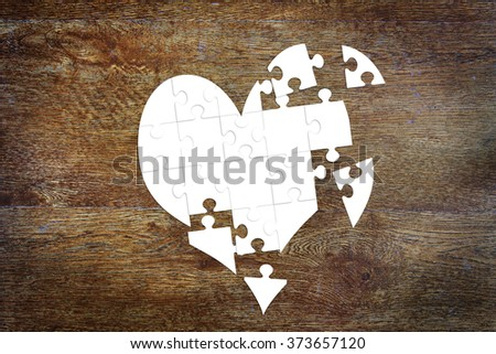 Broken heart as puzzles. Abstract image with paper scrapbooking - stock photo
