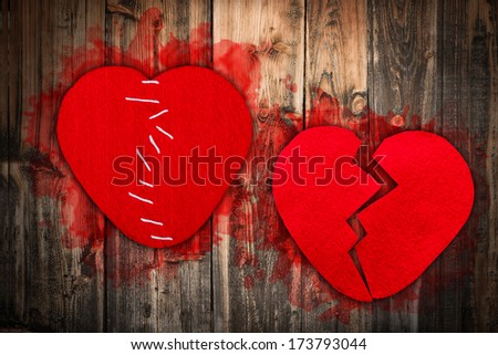 Broken heart concept: textile heart cut into parts and sewed together. - stock photo