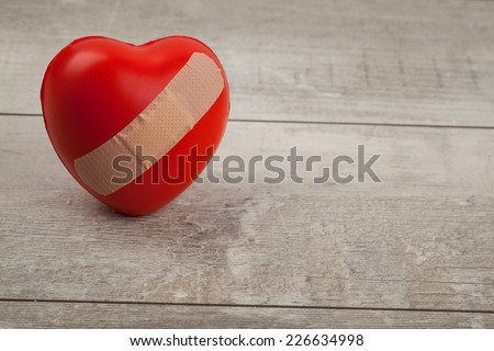 Broken heart on floor with copy space, Valentine's day greeting card.  - stock photo